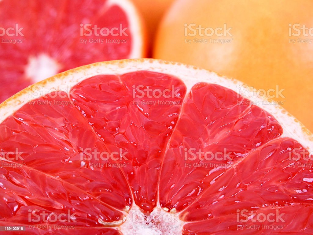 Macro photo of sliced grapefruits royalty-free stock photo