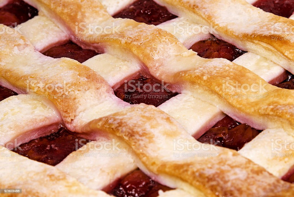 Macro photograph of a lattice pastry crust red cherry pie royalty-free stock photo