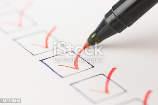 istock Macro photography of check mark over white background 882329946