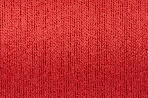 Macro picture of red thread texture surface background