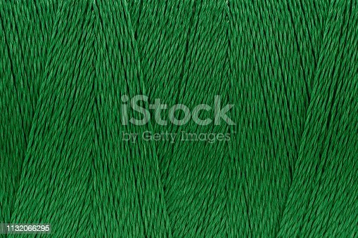 Macro picture of sew thread texture green color surface background