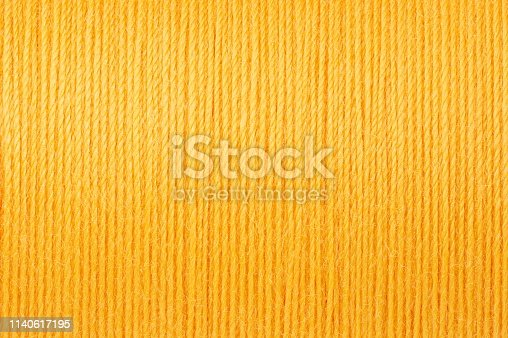 Macro picture of pastel yellow thread texture surface background