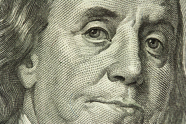 macro portrait of ben franklin - hoarding stock photos and pictures