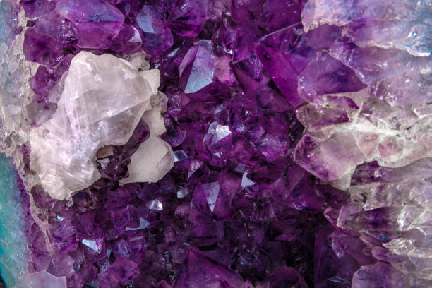 Macro raw mineral amethyst stone with calcite stock photo