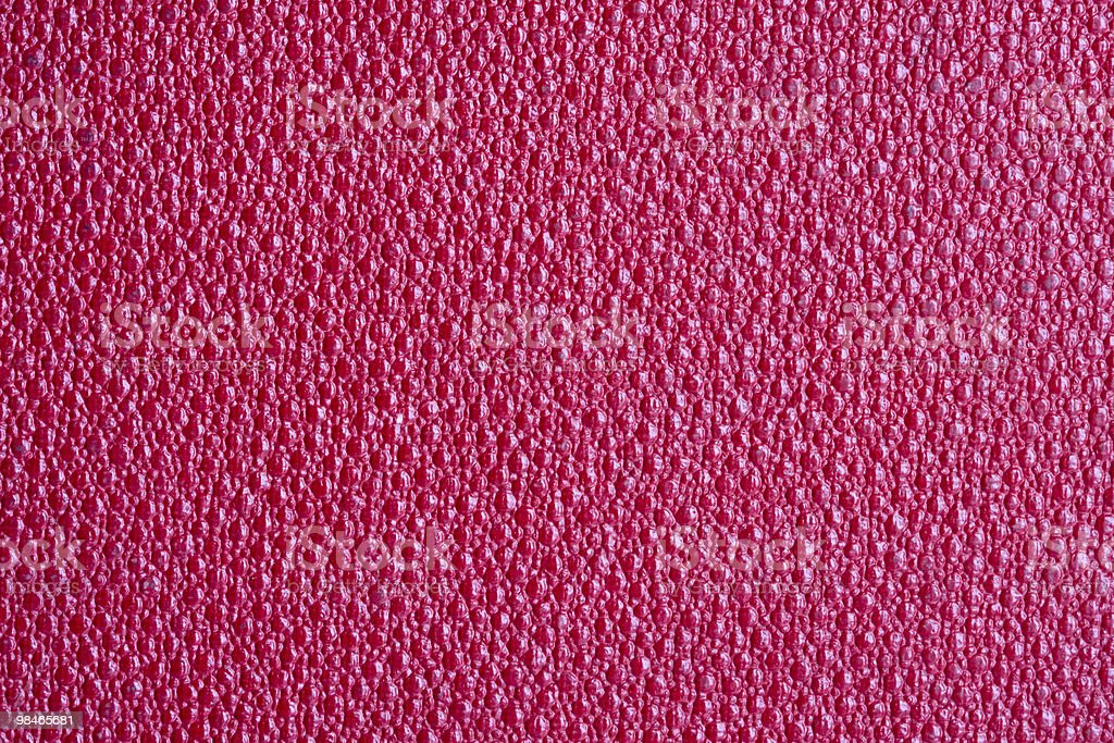 Macro red artificial leather background royalty-free stock photo