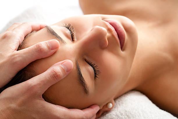 Macro relaxing facial massage. stock photo