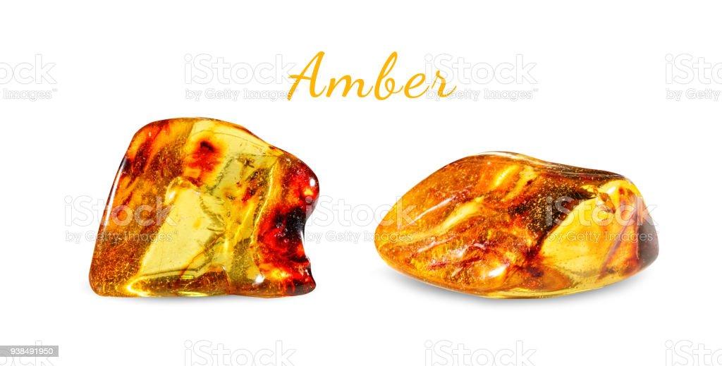 Macro shooting of natural gemstone. Polished amber. Gem stone. Isolated on white background stock photo