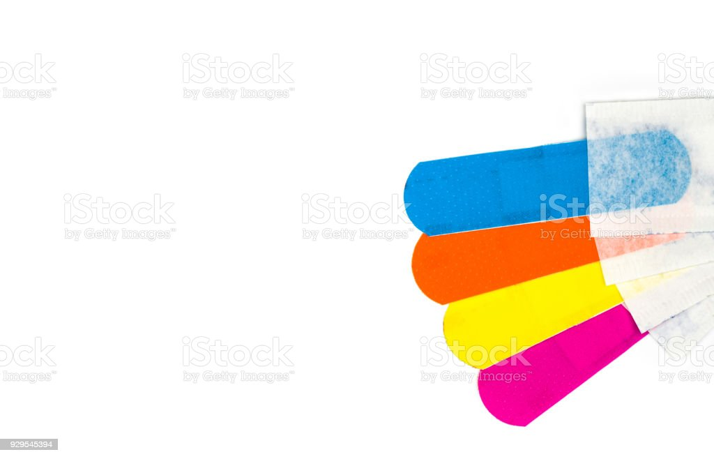 Macro shot detail of first aid dressing with non-stick pad for quick wound healing. Sterile wound dressing with bright color is easy to detect in food manufacturing industry stock photo