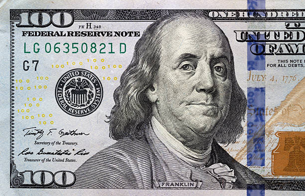 Macro shot of a 100 dollar Macro shot of a 100 dollar benjamin franklin stock pictures, royalty-free photos & images
