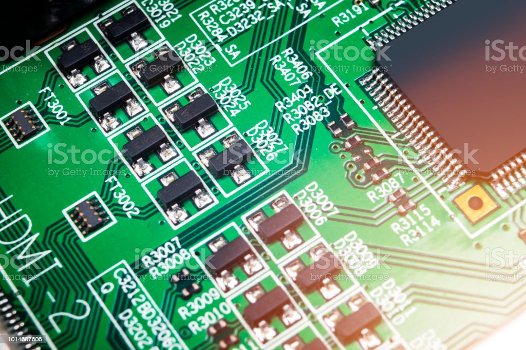 Macro Shot Of A Circuitboard With Resistors Microchips And