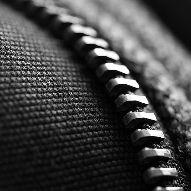 makro-aufnahme eines reißverschluss - legere arbeitskleidung stock-fotos und bilder