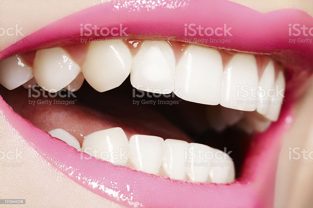 Macro shot of beautiful female smile with healthy white teeth stock photo