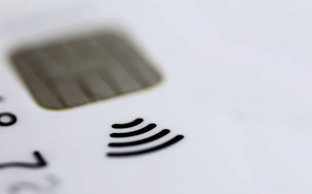 macro shot of contactless credit card chip with typical sign. - paying with card contactless imagens e fotografias de stock