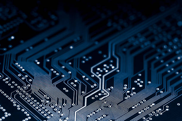 macro shot of electronic circuit board representing modern technology - mother board stock photos and pictures