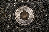 Macro shot of hex head bolt screw thread. Close up view of rustic hexagon screw head