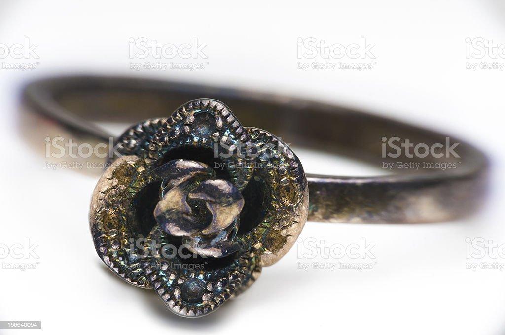 Macro shot of iridescent metal ring on white. royalty-free stock photo