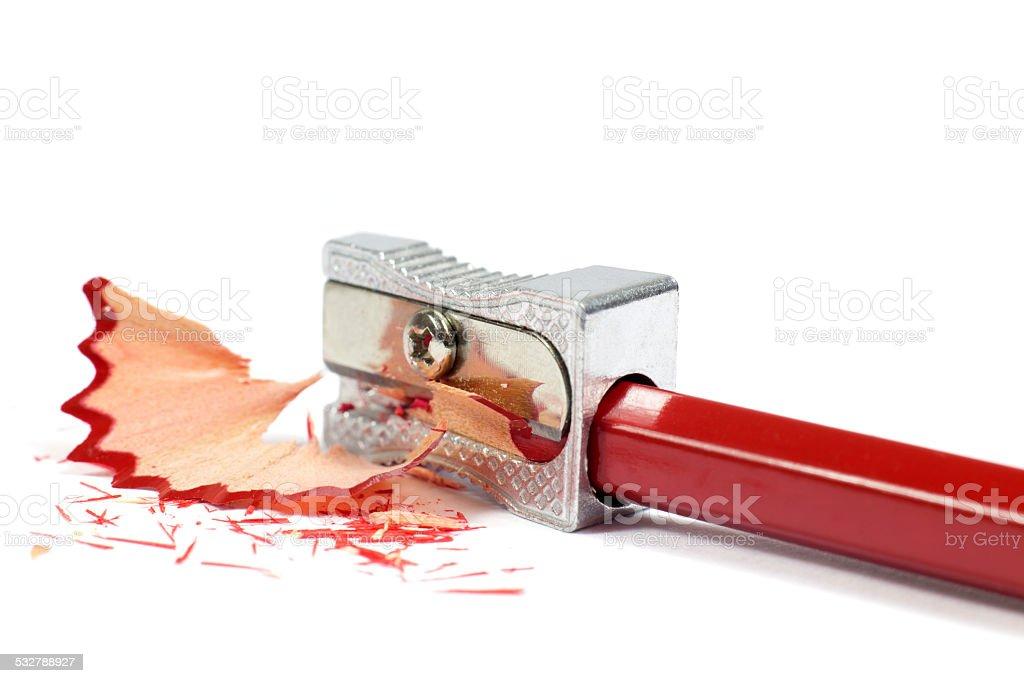 Macro Shot of Metallic Pencil Sharpener Sharpening Red Pencil Isolated stock photo