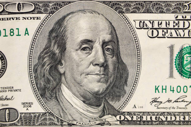 Macro shot of one hundred dollars bill Macro shot of one hundred dollars bill benjamin franklin stock pictures, royalty-free photos & images