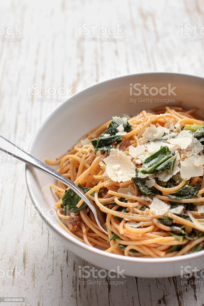 Macro shot of pasta dish with fork stock photo