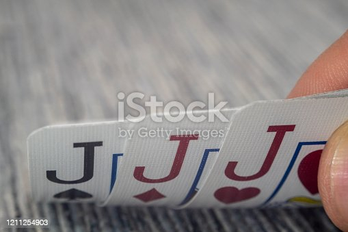istock Macro shot of playing cards on a casino table 1211254903