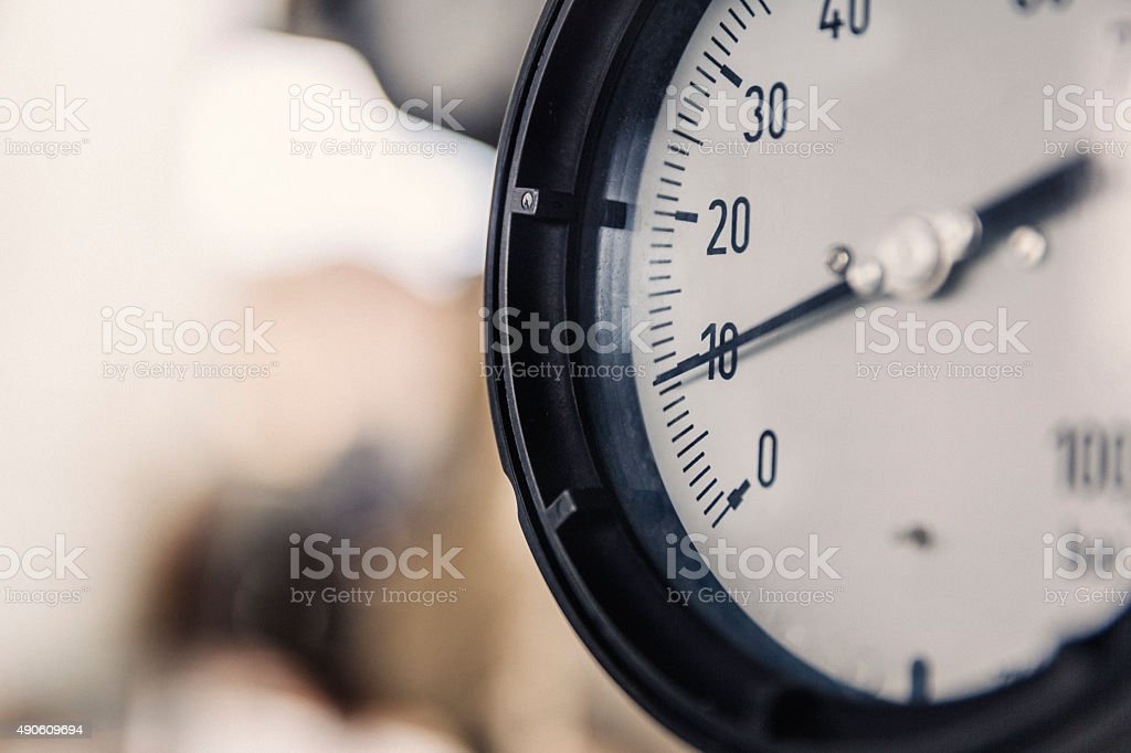 Macro shot of pressure gauge at factory stock photo