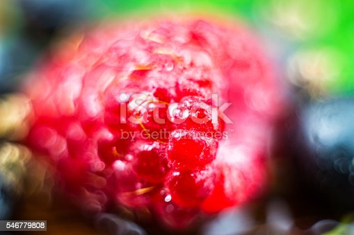istock Macro shot of ripe raspberries, blurred fruit background 546779808