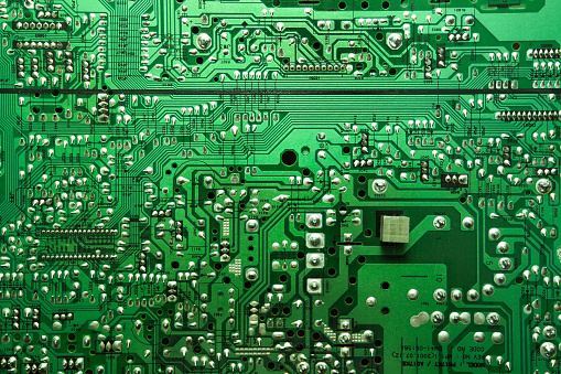 Macro shot of the back side of a circuit board. Concept background.