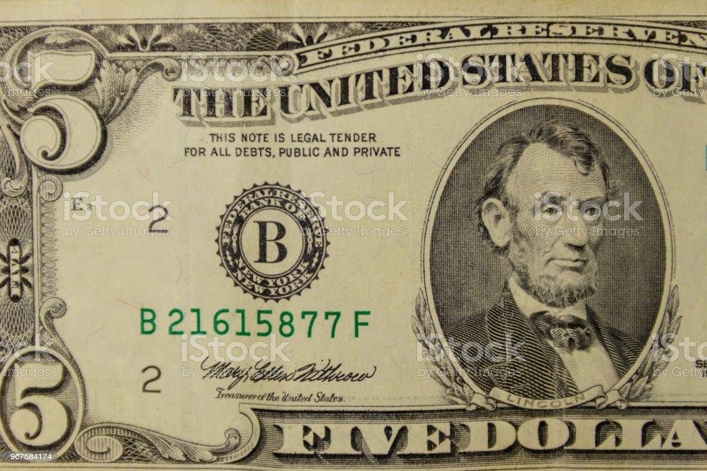 Macro shot of the five dollars banknote stock photo