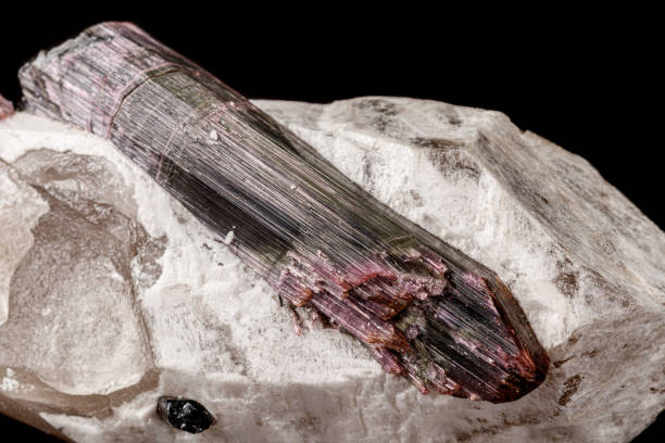 Cтоковое фото Macro stone tourmaline mineral on a black background
