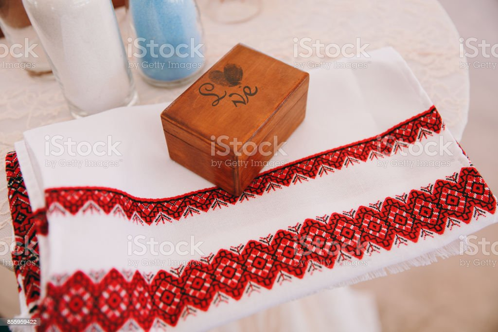 Macro texture of towels embroidered with the national red-white at the fair of folk crafts and brown box stock photo