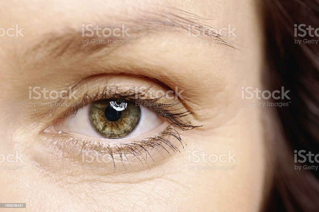 Macro view of a brown eye looking at you stock photo