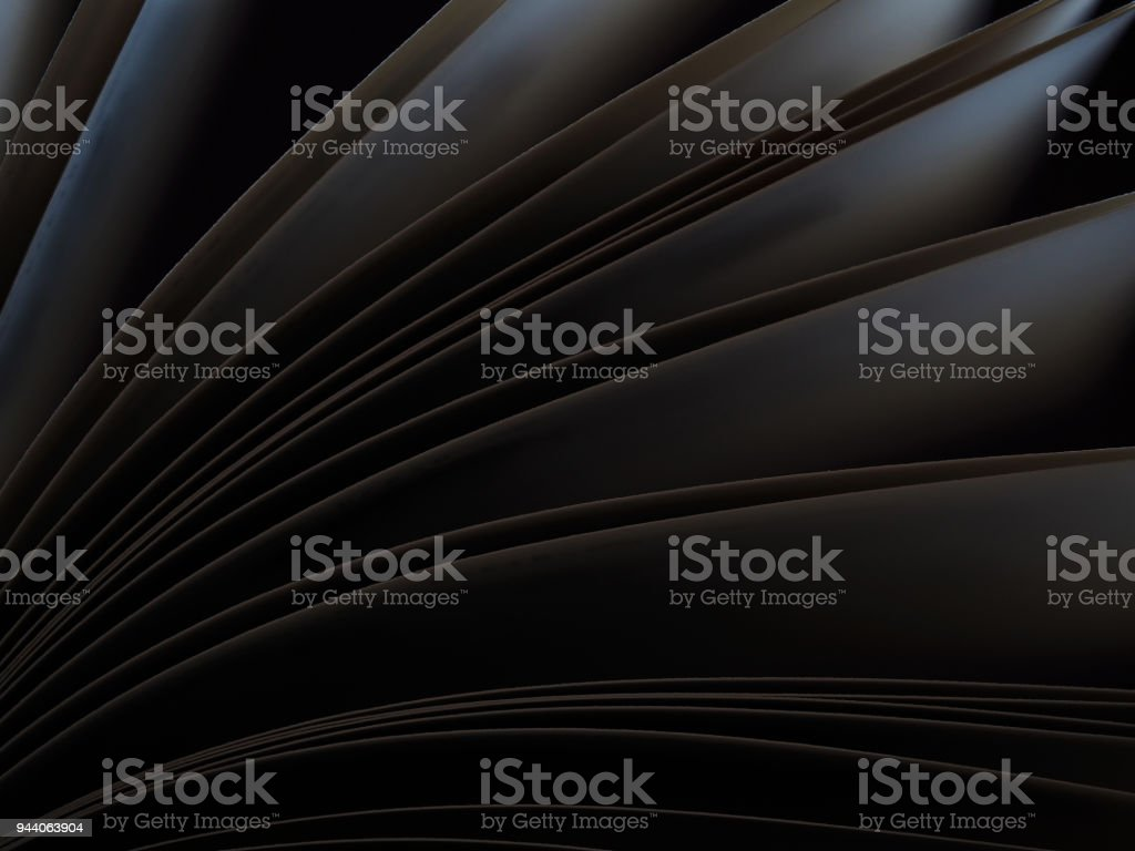 Macro view of book pages. Concept of open book, dark sheets on  black background. Education background. Close-up, selective focus stock photo