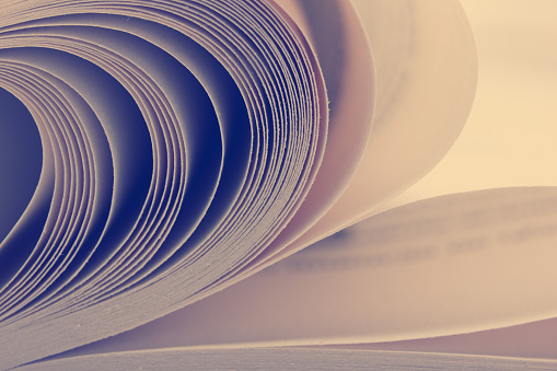 Macro view of book pages. Toned image. Copy space for