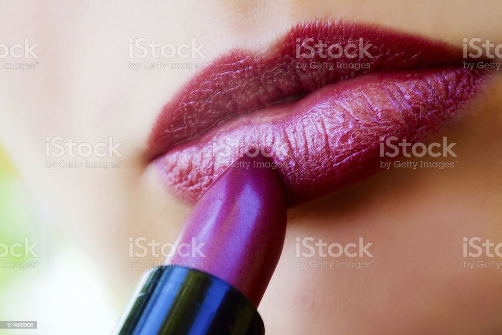 Macro view of female lips and red lipstick royalty-free stock photo