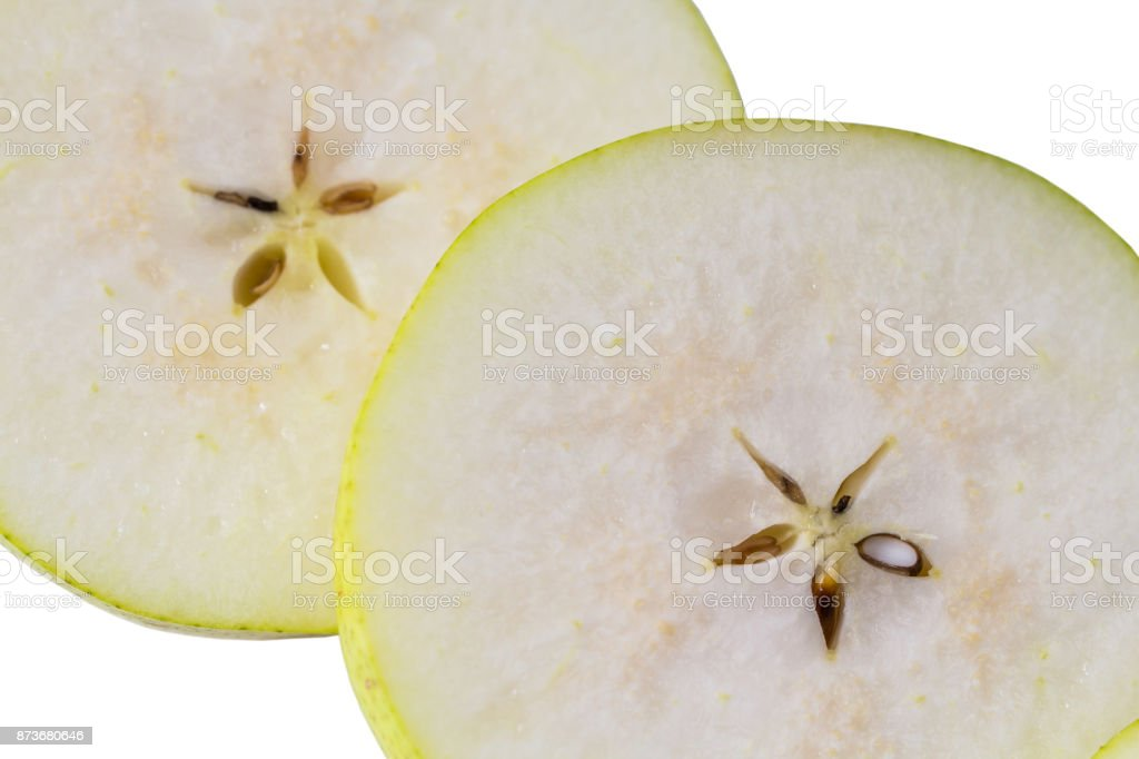 Macro view of pear slice. Nice background of cut fresh pear with seeds stock photo