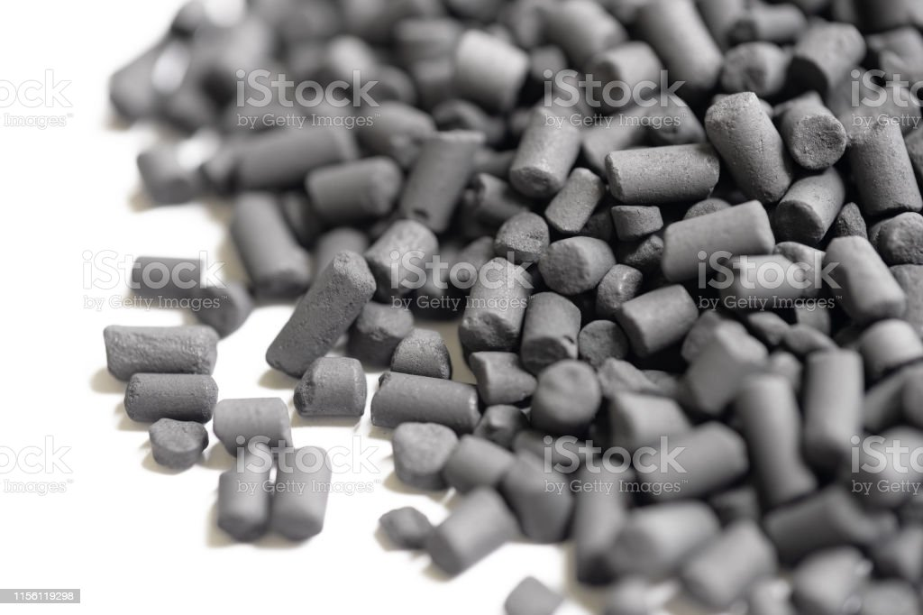 Macro view of small activated Carbon granules seen in a heap. royalty-free stock photo