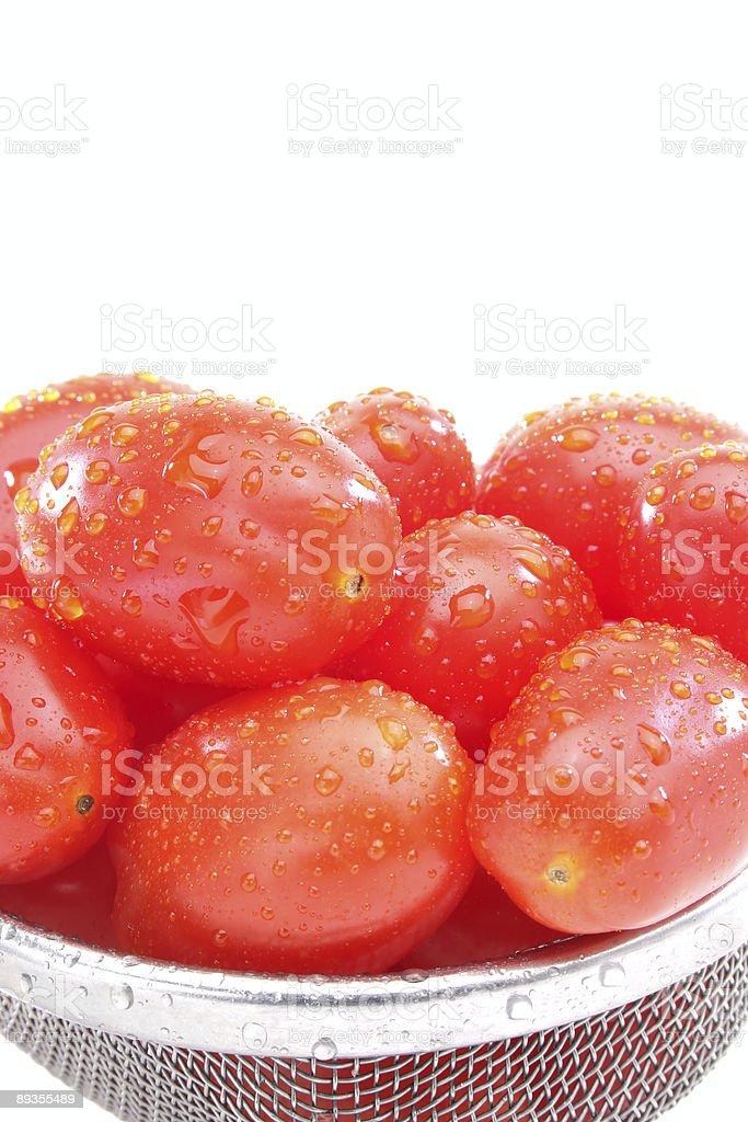 Macro wet grape tomatoes royaltyfri bildbanksbilder