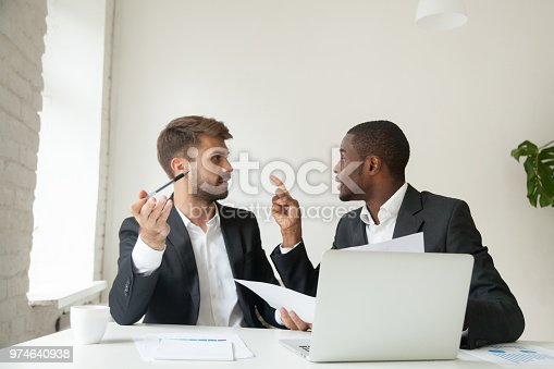 857213750istockphoto Mad African American arguing with Caucasian colleague about docu 974640938