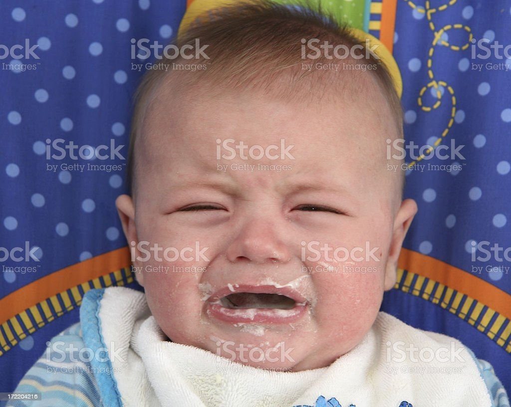 Mad Baby at Dinner stock photo