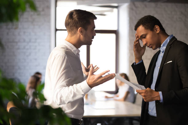 Mad boss lecture employee for bad financial report Angry Caucasian boss shouting at stressed African American employee, blaming for document mistake, mad employer lecture depressed black worker frustrated with bad financial statistics or report arguing stock pictures, royalty-free photos & images