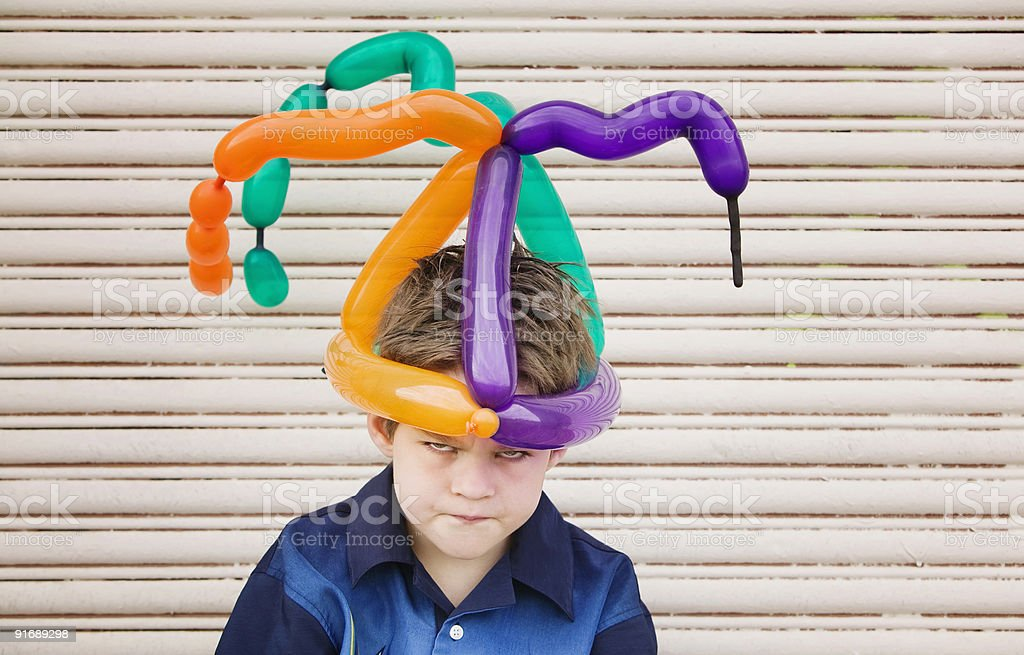 Mad Boy with a Balloon Hat royalty-free stock photo