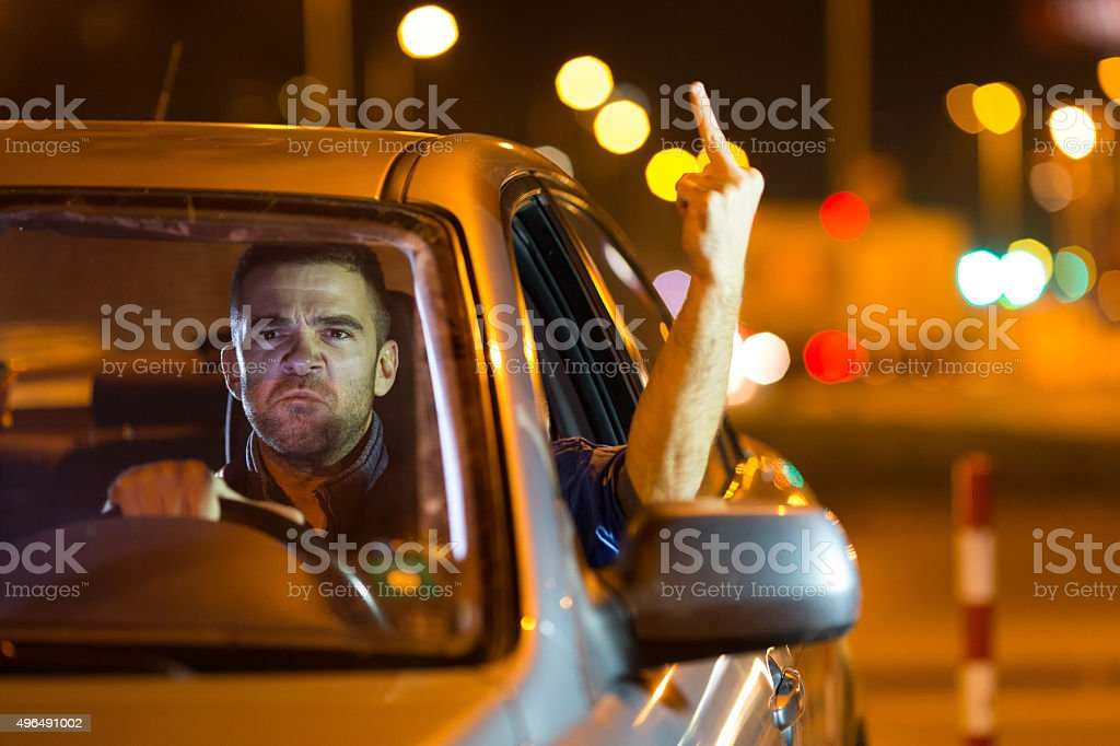 Mad driver showing the finger stock photo