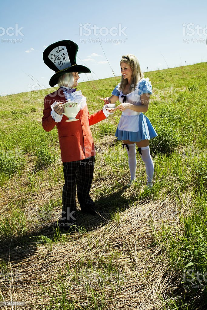 Mad Hatter and Alice in Wonderland stock photo