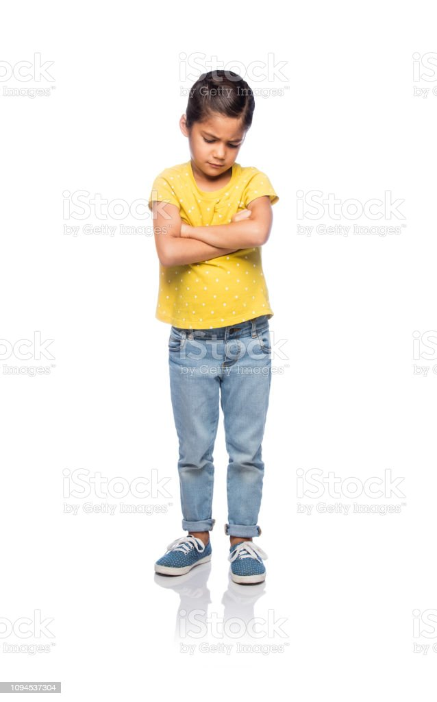 Mad little girl with her arms crossed stock photo