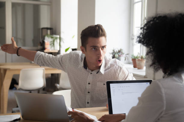 Mad male employee blaming female colleague for mistake Mad male worker yelling at female colleague asking her to leave office, multiracial coworkers disputing during business negotiations, employees cannot reach agreement, blaming for mistake or crisis agitation stock pictures, royalty-free photos & images