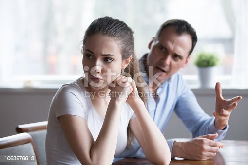 993706062 istock photo Mad man screaming or lecturing offended young lover 1063676618