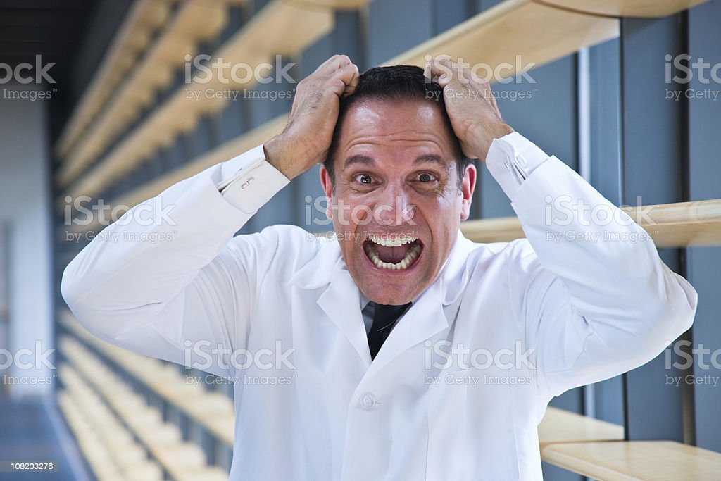 Mad scientist pulling hair royalty-free stock photo