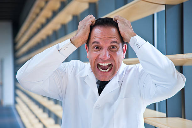 Mad scientist pulling hair stock photo