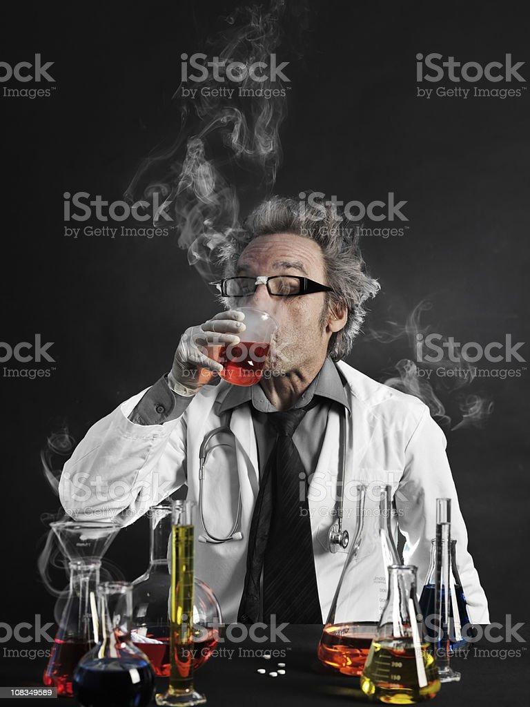 Mad scientist tasting liquid royalty-free stock photo