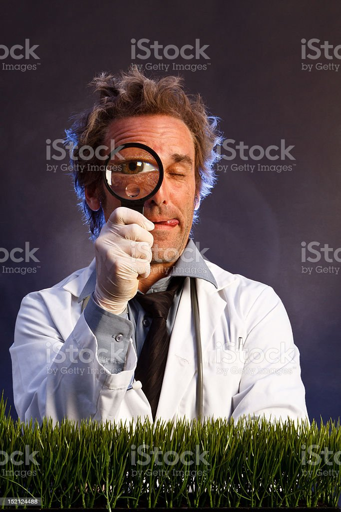 Mad Scientist with Magnifying Glass stock photo